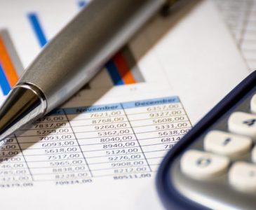 economics-calculator-pen